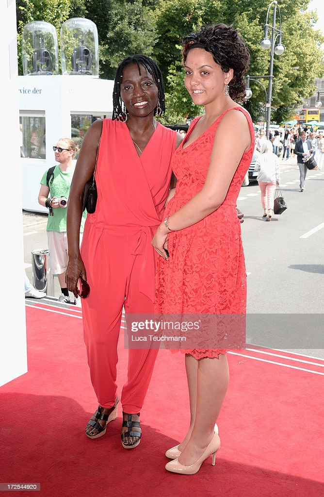 Auma Obama and her daughter Akini attend the Minx By Eva Lutz Show during the Mercedes-Benz Fashion Week Spring/Summer 2014 at the Brandenburg Gate on July 3, 2013 in Berlin, Germany.