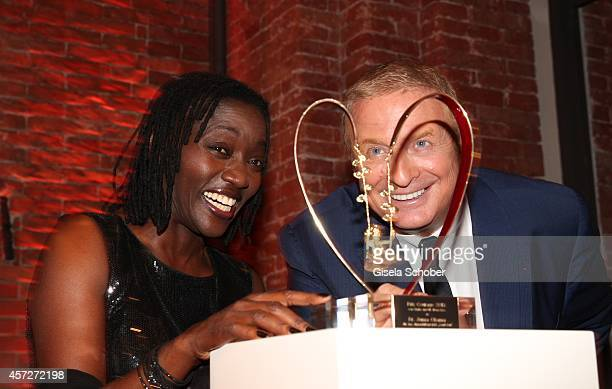 Auma Obama founder 'Sauti Kuu' and Christian Courtin Clarins CEO Clarins attend the Prix Courage Award 2014 on October 15 2014 at...