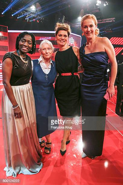 Auma Obama Karoline Mayer Sarah Wiener and Bettina Wulff attend the Ein Herz Fuer Kinder Gala 2015 show at Tempelhof Airport on December 5 2015 in...