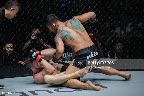 Aung La N Sang outstruck Vitaly Bigdash to claim the ONE Middleweight World Championship during ONE Championship Light Of A Nation at the Thuwunna...