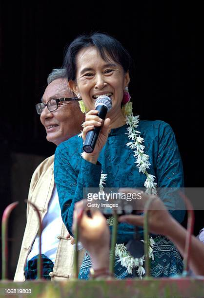 Aung San Suu Kyi addresses thousands of her supporters at her National League for Democracy headquarters on November 14 2010 in Yangon Burma...