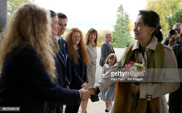 Aung San Suu Kyi is welcomed by pupils from Wellington College in Belfast The Nobel laureate has said lessons from Northern Ireland's peace process...