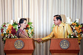 Aung San Suu Kyi Myanmar state counselor left shakes hands wtih Prayuth ChanOcha Thailand's prime minister looks on during a news conference at the...