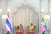 Aung San Suu Kyi Myanmar state counselor left speaks as Prayuth ChanOcha Thailand's prime minister looks on during a news conference at the...