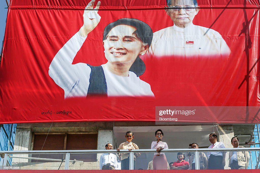 Aung San Suu Kyi Myanmar's opposition leader and chairperson of the National League for Democracy center right delivers a speech flanked by Tin Oo...
