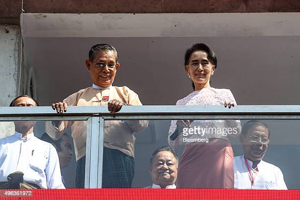 Aung San Suu Kyi Myanmar's opposition leader and chairperson of the National League for Democracy right and Tin Oo cofounder of the NLD stand on a...