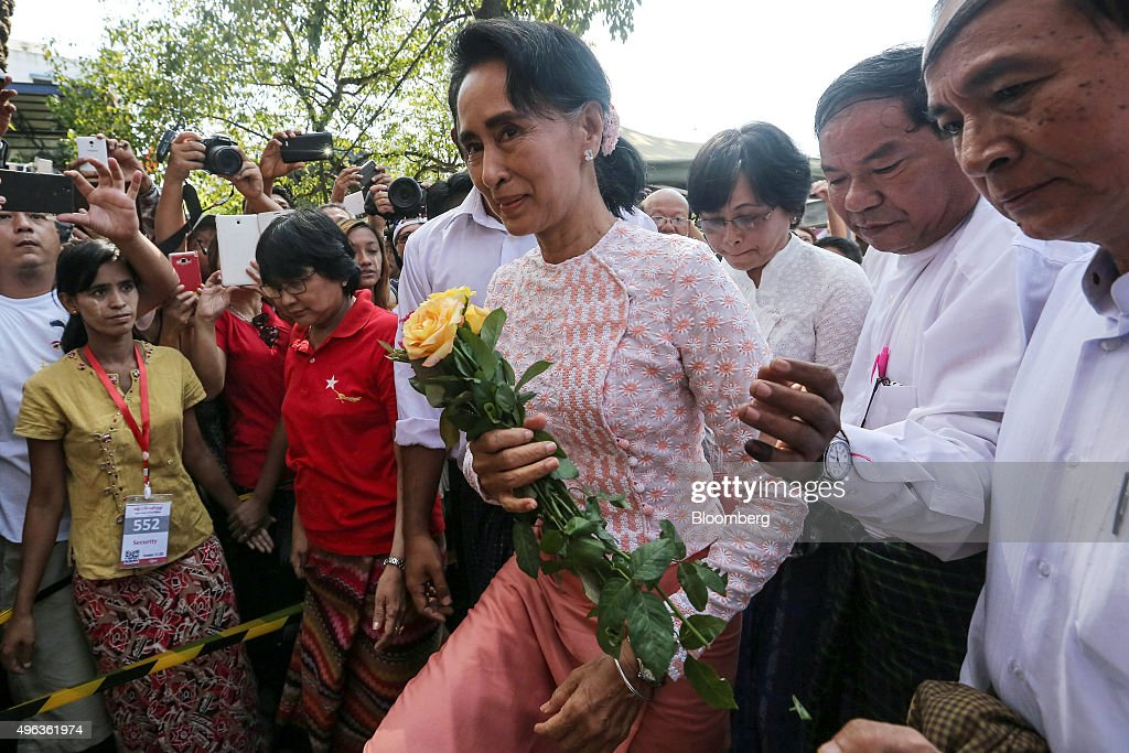<a gi-track='captionPersonalityLinkClicked' href=/galleries/search?phrase=Aung+San+Suu+Kyi&family=editorial&specificpeople=214208 ng-click='$event.stopPropagation()'>Aung San Suu Kyi</a>, Myanmar's opposition leader and chairperson of the National League for Democracy (NLD), center, arrives at the party headquarters in Yangon, Myanmar, on Monday, Nov. 9, 2015. Suu Kyi warned supporters anticipating an historic election victory over the military-backed ruling party that results are not final and they need to remain cautious. Photographer: Dario Pignatelli/Bloomberg via Getty Images