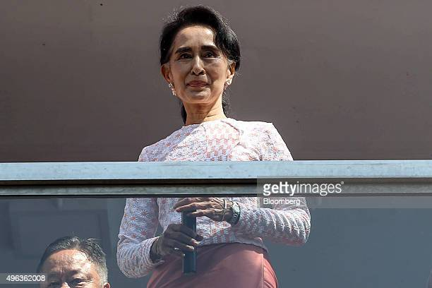 Aung San Suu Kyi Myanmar's opposition leader and chairperson of the National League for Democracy stands on a balcony at the party headquarters in...