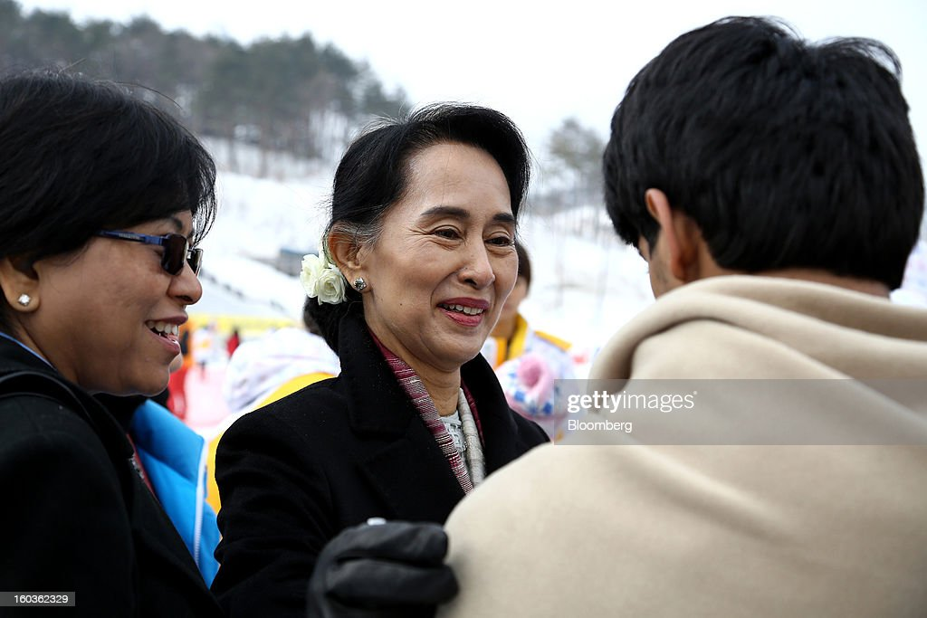 <a gi-track='captionPersonalityLinkClicked' href=/galleries/search?phrase=Aung+San+Suu+Kyi&family=editorial&specificpeople=214208 ng-click='$event.stopPropagation()'>Aung San Suu Kyi</a>, Myanmar's opposition leader, center, greets an athlete, right, at the 2013 Pyeongchang Special Olympics Winter Games in Pyeongchang, South Korea, on Wednesday, Jan. 30, 2013. Suu Kyi is on a five-day visit to South Korea. Photographer: SeongJoon Cho/Bloomberg via Getty Images