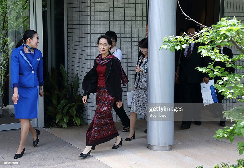 <a gi-track='captionPersonalityLinkClicked' href=/galleries/search?phrase=Aung+San+Suu+Kyi&family=editorial&specificpeople=214208 ng-click='$event.stopPropagation()'>Aung San Suu Kyi</a>, Myanmar's opposition leader, center, leaves Panasonic Center Tokyo in Tokyo, Japan, on Thursday, April 18, 2013. Suu Kyi said on April 17 foreign investment in the newly democratizing nation is being held up by inadequate infrastructure and uncertainty over investment laws. Photographer: Tomohiro Ohumi/Bloomberg via Getty Images