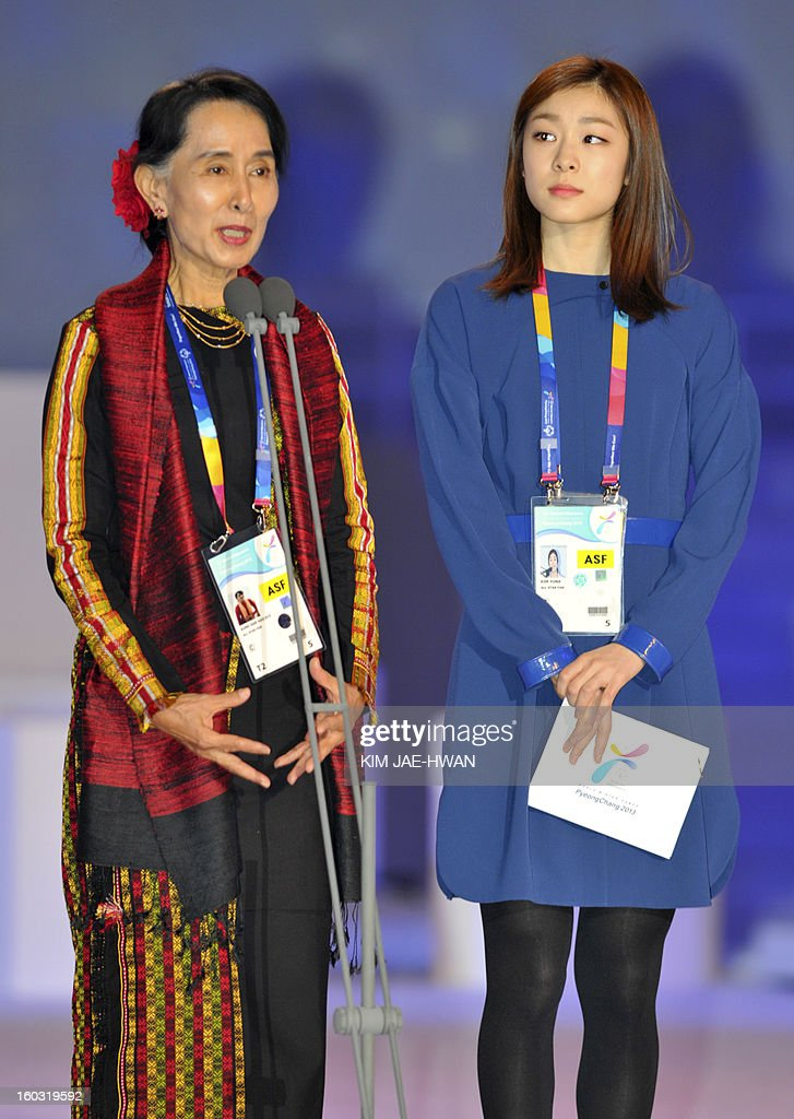 Aung San Suu Kyi (L), Myanmar's opposition leader, delivers a speech as Olympic figure skating gold medalist Kim Yuna (R) watches at the opening of the Special Olympics World Winter Games in Pyeongchang, about 180 km (112 miles), east of Seoul on January 29, 2013. The democracy leader and Nobel peace laureate was a guest of honour at the opening of the Special Winter Olympics in the northeastern mountain resort of Pyeongchang -- site of the full 2018 Winter Games. AFP PHOTO / KIM JAE-HWAN / POOL