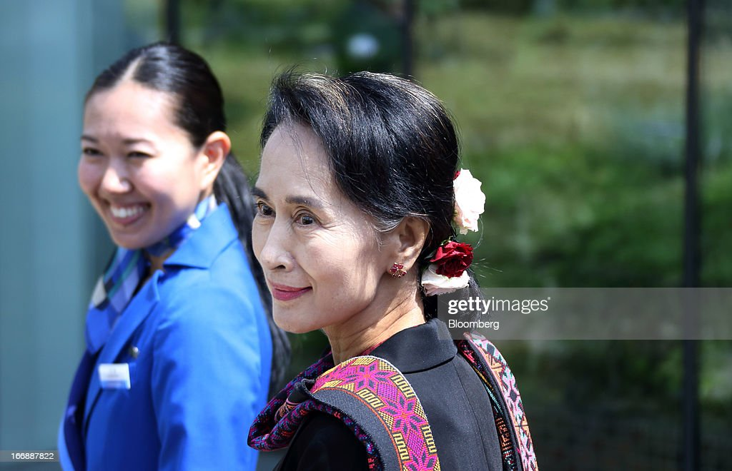 <a gi-track='captionPersonalityLinkClicked' href=/galleries/search?phrase=Aung+San+Suu+Kyi&family=editorial&specificpeople=214208 ng-click='$event.stopPropagation()'>Aung San Suu Kyi</a>, Myanmar's opposition leader, right, accompanied by a Panasonic employee, leaves Panasonic Center Tokyo in Tokyo, Japan, on Thursday, April 18, 2013. Suu Kyi said on April 17 foreign investment in the newly democratizing nation is being held up by inadequate infrastructure and uncertainty over investment laws. Photographer: Tomohiro Ohumi/Bloomberg via Getty Images