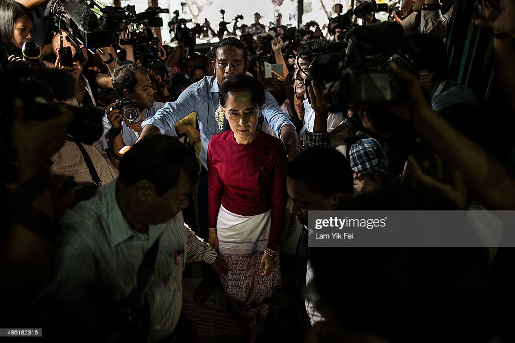 <a gi-track='captionPersonalityLinkClicked' href=/galleries/search?phrase=Aung+San+Suu+Kyi&family=editorial&specificpeople=214208 ng-click='$event.stopPropagation()'>Aung San Suu Kyi</a>, the Burmese opposition politician, chairperson of the National League for Democracy (NLD) in Burma, and Nobel Peace Prize winner, arrives at the polling station to cast vote during Myanmar's first free and fair election on November 8, 2015 in Yangon, Myanmar. The elections will be Myanmar's first openly contested polls in 25 years, following decades of military rule.