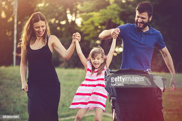 Aunt and uncle having fun with their niece in nature