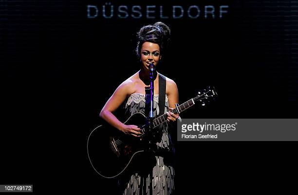 Aura Dione performs during the Designer For Tomorrow Show during the Mercedes Benz Fashion Week Spring/Summer 2011 at Bebelplatz on July 9 2010 in...