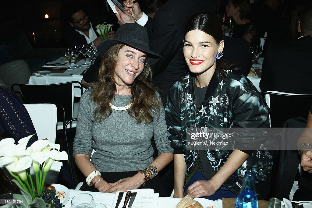 Aurelie Bidermann (L) and Hanneli Mustaparta attend the Glamour dinner for Patrick Demarchelier as part of the Paris Fashion Week Womenswear Spring/Summer 2014 at Monsieur Bleu restaurant on September 29, 2013 in Paris, France.