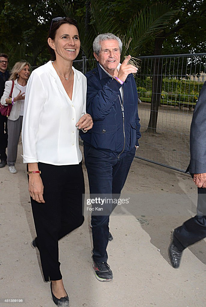 Aurelie Filippetti and <a gi-track='captionPersonalityLinkClicked' href=/galleries/search?phrase=Claude+Lelouch&family=editorial&specificpeople=207051 ng-click='$event.stopPropagation()'>Claude Lelouch</a> attend the Fete des Tuileries' : Opening Party Hosted By Marcel Campion At Jardin des Tuileries on June 27, 2014 in Paris, France.