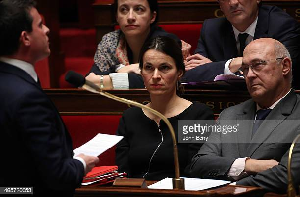 Aurelie Filippetti French Minister of Culture and Communication and Michel Sapin French Minister of Labour Employment and Social Dialogue listen to...