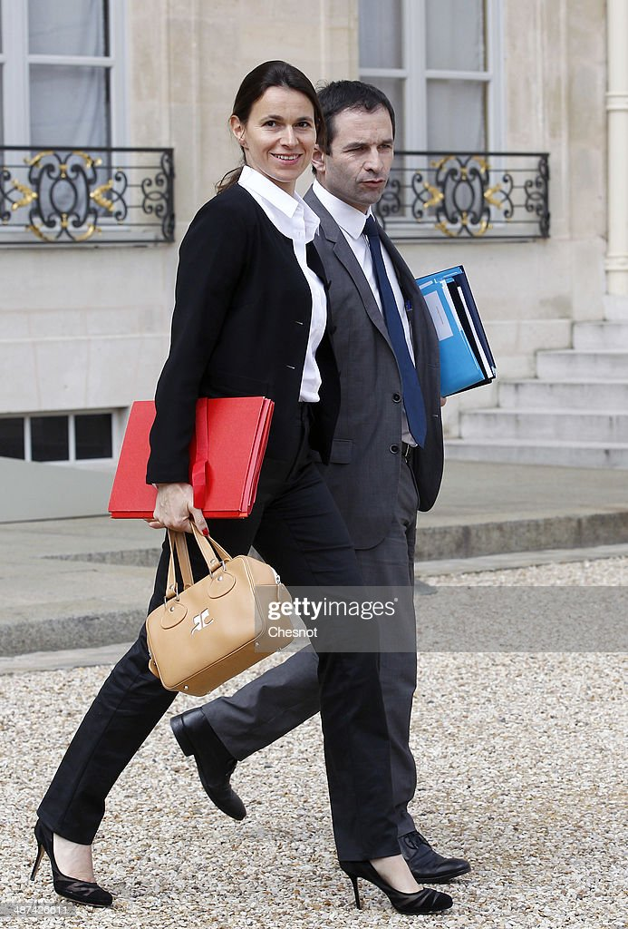 Aurelie Filippetti, Minister of Culture and Communication and Benoit Hamon, Minister of National Education, Higher Education and Research leave after a cabinet meeting at the Elysee Palace on April 30, 2014 in Paris, France. It is the fifth weekly cabinet meeting of France's newly appointed government of Prime Minister Manuel Valls.