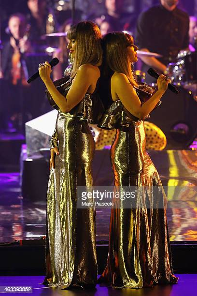 Aurelie Saada and Sylvie Hoarau from Brigitte perform during the 30th 'Victoires de la Musique' French Music Awards Ceremony at le Zenith on February...