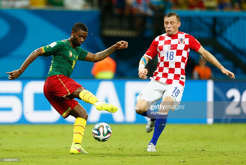 <a gi-track='captionPersonalityLinkClicked' href=/galleries/search?phrase=Aurelien+Chedjou&family=editorial&specificpeople=4520971 ng-click='$event.stopPropagation()'>Aurelien Chedjou</a> of Cameroon controls the ball against <a gi-track='captionPersonalityLinkClicked' href=/galleries/search?phrase=Ivica+Olic&family=editorial&specificpeople=547277 ng-click='$event.stopPropagation()'>Ivica Olic</a> of Croatia during the 2014 FIFA World Cup Brazil Group A match between Cameroon and Croatia at Arena Amazonia on June 18, 2014 in Manaus, Brazil.