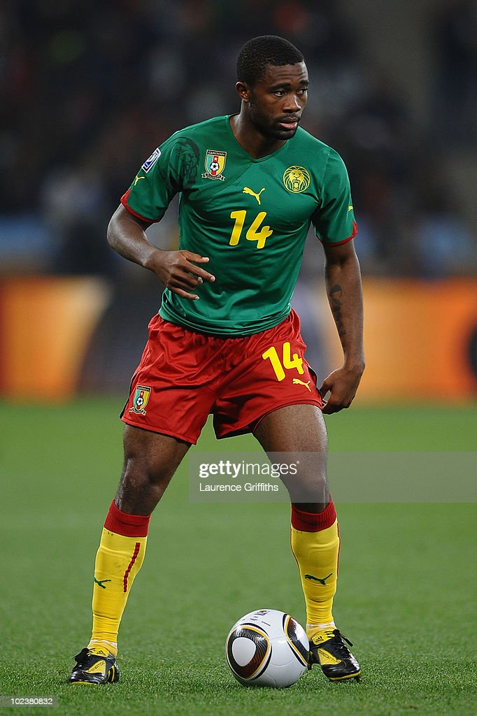 <a gi-track='captionPersonalityLinkClicked' href=/galleries/search?phrase=Aurelien+Chedjou&family=editorial&specificpeople=4520971 ng-click='$event.stopPropagation()'>Aurelien Chedjou</a> of Cameroon runs with the ball during the 2010 FIFA World Cup South Africa Group E match between Cameroon and Netherlands at Green Point Stadium on June 24, 2010 in Cape Town, South Africa.