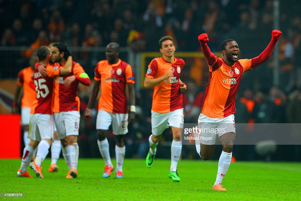 Aurelien Chedjou of Galatasaray (R) celebrates scoring their first goal during the UEFA Champions League Round of 16 first leg match between Galatasaray AS and Chelsea at Ali Sami Yen Arena on February 26, 2014 in Istanbul, Turkey.
