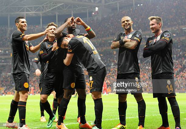 Aurelien Chedjou of Galatasaray celebrates with his teammates Burak Yilmaz and Felipe Melo after scoring a goal during the Turkish Spor Toto Super...