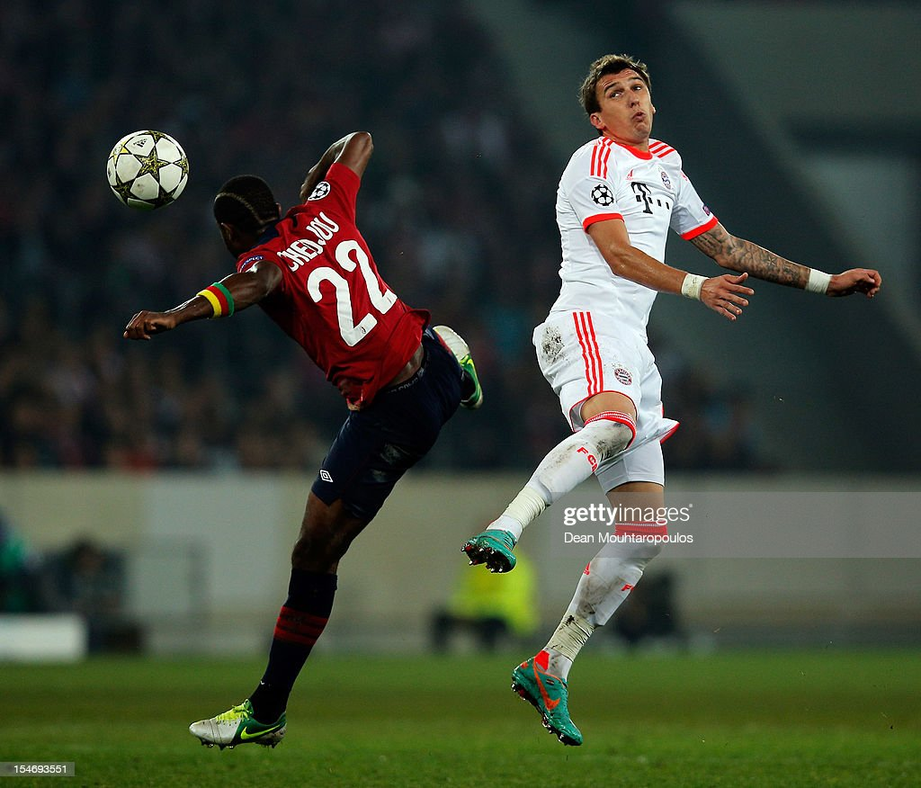 <a gi-track='captionPersonalityLinkClicked' href=/galleries/search?phrase=Aurelien+Chedjou&family=editorial&specificpeople=4520971 ng-click='$event.stopPropagation()'>Aurelien Chedjou</a> of Lille and <a gi-track='captionPersonalityLinkClicked' href=/galleries/search?phrase=Mario+Mandzukic&family=editorial&specificpeople=4476149 ng-click='$event.stopPropagation()'>Mario Mandzukic</a> of Bayern Munich battle for the ball during the Group F UEFA Champions League match between OSC Lille and FC Bayern Muenchen at Grand Stade Lille Metropole on October 23, 2012 in Lille, France.