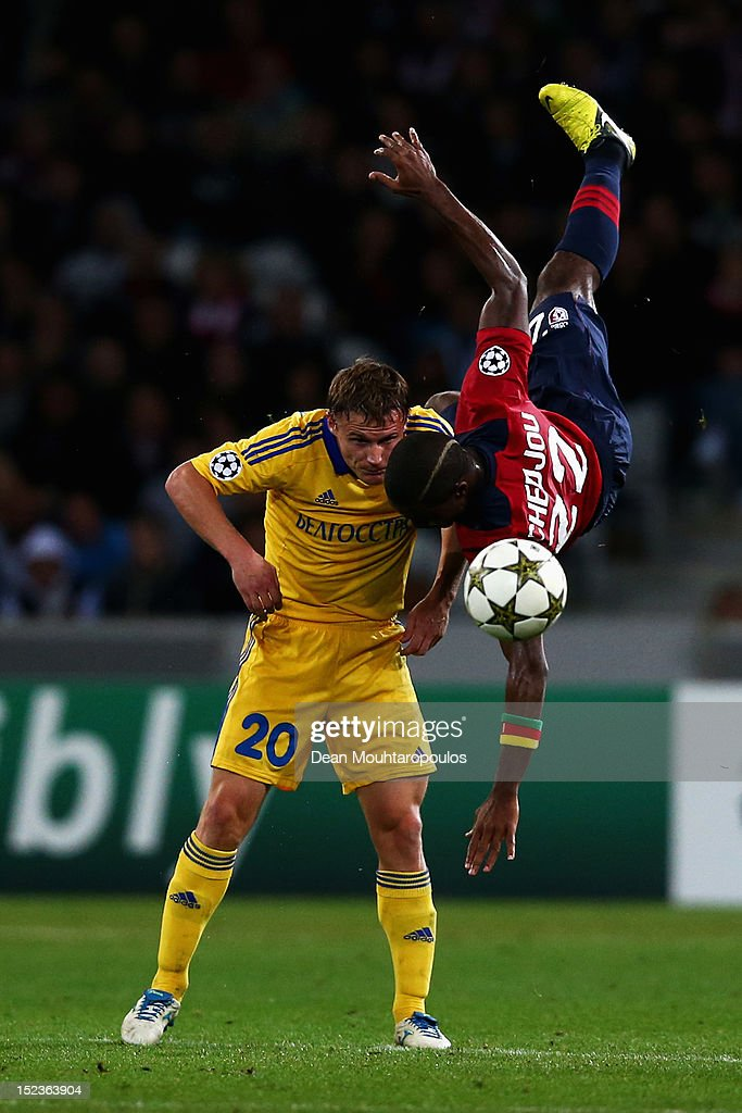 Aurelien Chedjou of Lille heads the ball and falls over Vitali Rodionov of BATE during the Group F UEFA Champions League match between LOSC Lille Metropole and FC BATE Borisov at the Grand Stade Lille Metropole on September 19, 2012 in Lille, France.