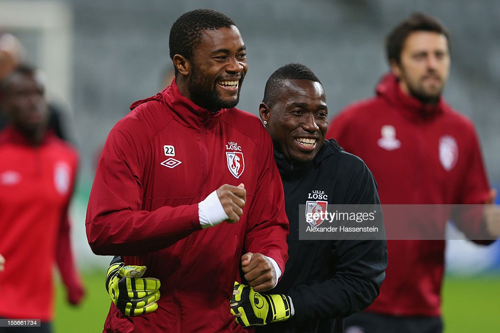 Aurelien Chedjou (L) smiles with his team mate Barel Mouko during a OSC Lille training session ahead of their UEFA Champions League group F match against FC Bayern Muenchen at Allianz Arena on November 6, 2012 in Munich, Germany.