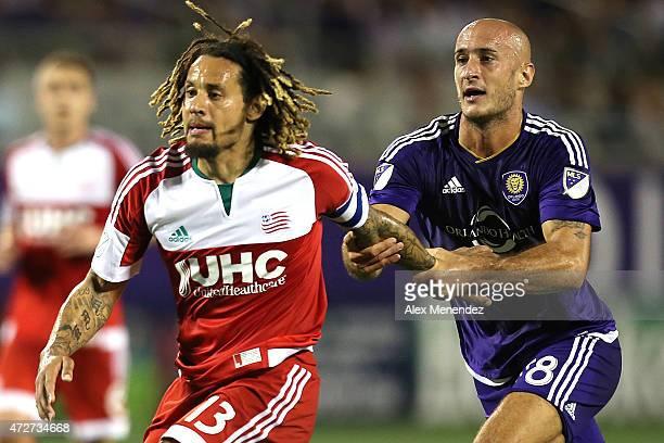 Aurelien Collin of Orlando City SC grabs a running Jermaine Jones of New England Revolution during an MLS soccer match between the New England...