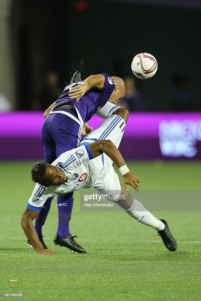 Aurelien Collin #78 of Orlando City SC is kicked in the face by Didier Drogba #11 of Montreal Impact during an MLS soccer match between the Montreal Impact and the Orlando City SC at the Orlando Citrus Bowl on October 3, 2015 in Orlando, Florida. Orlando won the match 2-1.