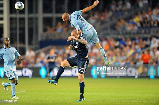 Aurelien Collin of Sporting Kansas City heads the ball over Eric Hassli of Vancouver Whitecaps FC on June 25 2011 at LiveStrong Sporting Park in...