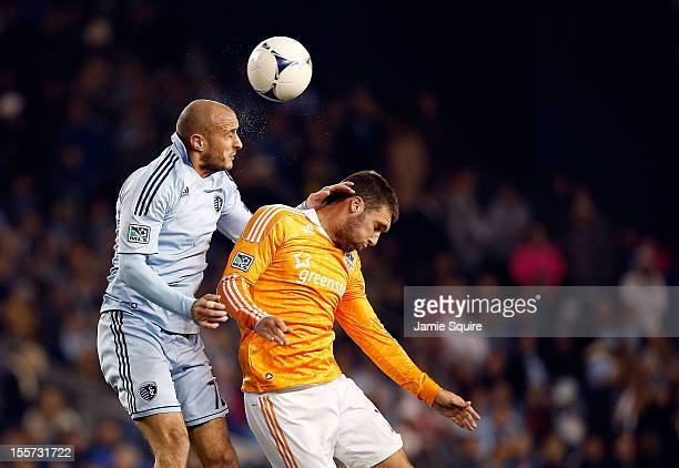 Aurelien Collin of Sporting KC beats Will Bruin of Houston Dynamo for a head ball during the Eastern Conference Semifinal game at LiveStrong Sporting...