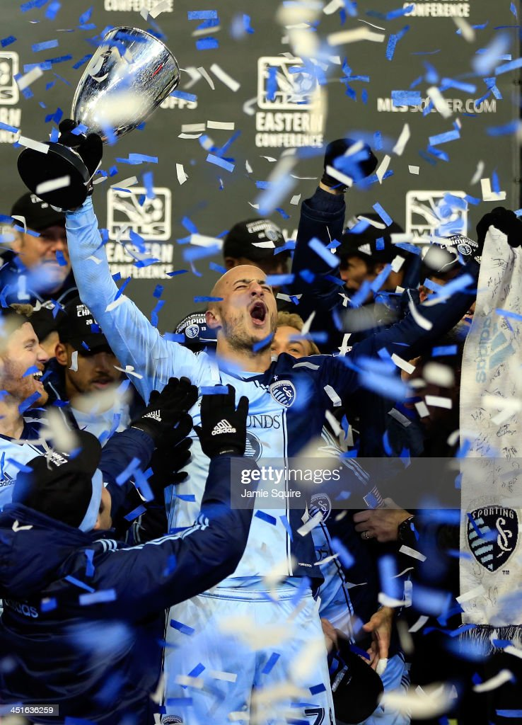 Aurelien Collin #78 of Sporting KC celebrates with the trophy after Sporting KC defeated the Houston Dynamo to win the Eastern Conference Championship at Sporting Park on November 23, 2013 in Kansas City, Kansas.