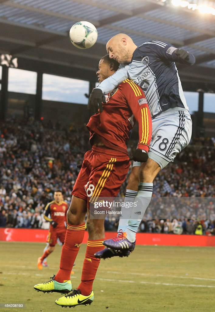 Aurelien Collin #78 of Sporting KC leaps for the ball against Chris Schuler #28 of Real Salt Lake in the second half of the 2013 MLS Cup at Sporting Park on December 7, 2013 in Kansas City, Kansas.