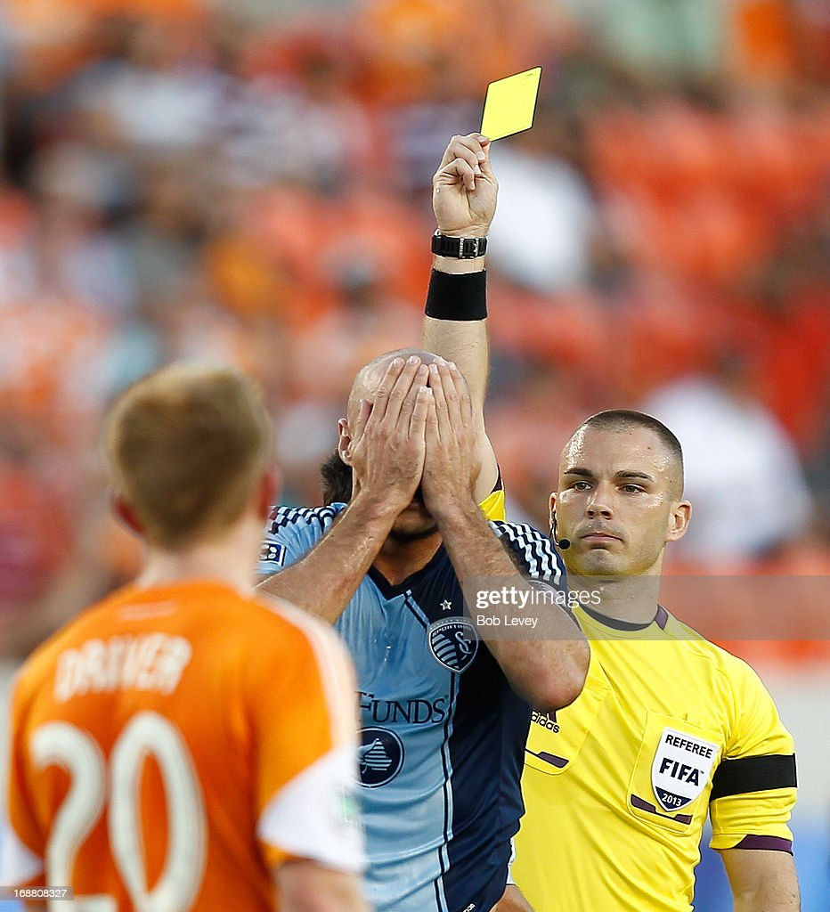 Aurelien Collin #78 of Sporting KC reacts after getting a yellow card against the Houston Dynamo at BBVA Compass Stadium on May 12, 2013 in Houston, Texas.
