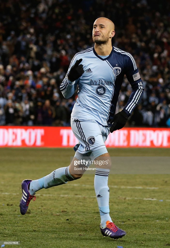 Aurelien Collin #78 of Sporting KC reacts to scoring during the shootout against Real Salt Lake during the 2013 MLS Cup at Sporting Park on December 7, 2013 in Kansas City, Kansas.