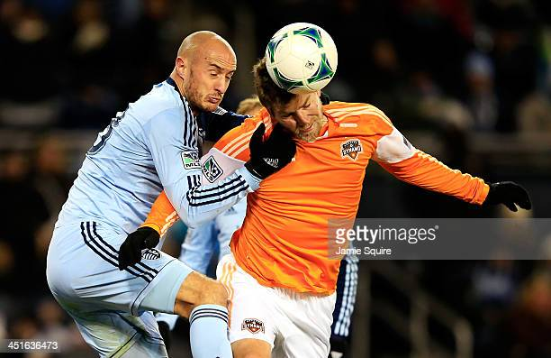 Aurelien Collin of the Sporting KC and Bobby Boswell of the Houston Dynamo compete for a head ball during Leg 2 of the Eastern Conference...