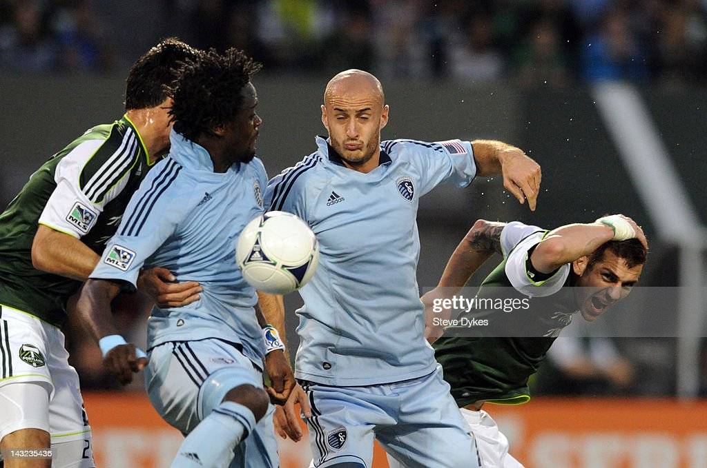 <a gi-track='captionPersonalityLinkClicked' href=/galleries/search?phrase=Aurelien+Collin&family=editorial&specificpeople=6600561 ng-click='$event.stopPropagation()'>Aurelien Collin</a> #78 of the Sporting KC heads the ball as Eric Brunner #5 of the Portland Timbers reacts during the first half of the game at Jeld-Wen Field on April 21, 2012 in Portland, Oregon.