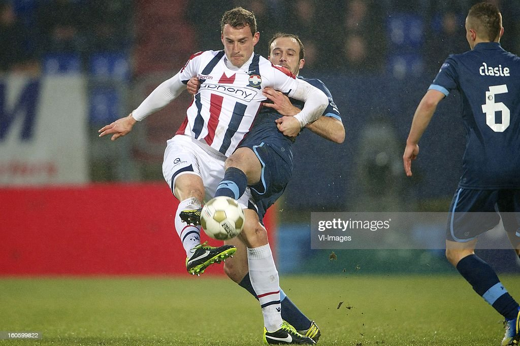 Aurelien Joachim of Willem II, Joris Mathijssen of Feyenoord during the Dutch Eredivisie match between Willem II and Feyenoord at the Koning Willem II Stadium on february 3, 2013 in Tilburg, The Netherlands