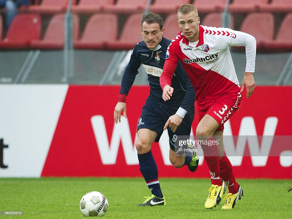 Aurelien Joachim of Willem II, Mike van der Hoorn of FC Utrecht during the Dutch Eredivise match between FC Utrecht and Willem II at the Galgenwaard Stadium on January 27, 2013 in Utrecht, The Netherlands.