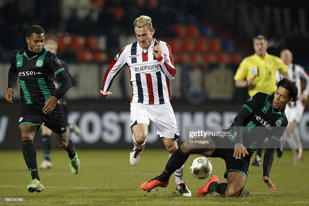 Aurelien Joachim of Willem II (C), Virgil van Dijk of FC Groningen (R) during the Dutch Eredivisie match between Willem II and FC Groningen at the Koning Willem II Stadium on march 30, 2013 in Tilburg, The Netherlands