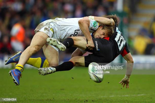 Aurelien Rougerie Clemont Auvergne Captain tackles Chris Wyles of Saracens during the Heineken Cup Quater Final match between Saracens and ASM...