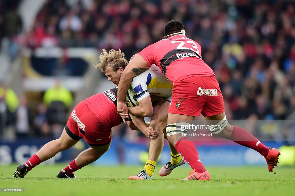 Aurelien Rougerie of Clermont is tackled by Alexandre Menini of Toulon and Romain Taofifenua of Toulon during the European Rugby Champions Cup Final match between ASM Clermont Auvergne and RC Toulon at Twickenham Stadium on May 2, 2015 in London, England.