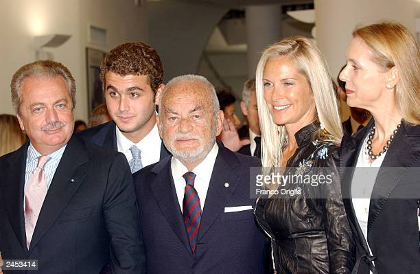 Aurelio de Laurentiis his son producer Dino de Laurentiis his wife Marta and Aurelio de Laurentiis's wife pose as they arrive at the ceremony for the...