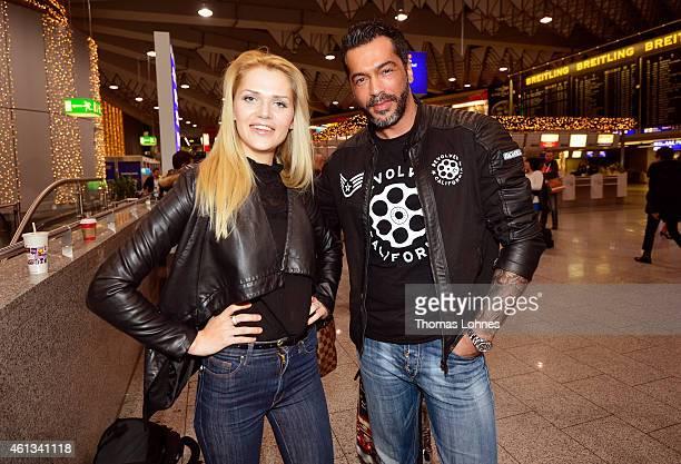 Aurelio Savina and Sarah Kulka pose before the flight to Australia as a participant in the 2015 RTLTVShow 'Dschungelcamp Ich bin ein Star Holt mich...