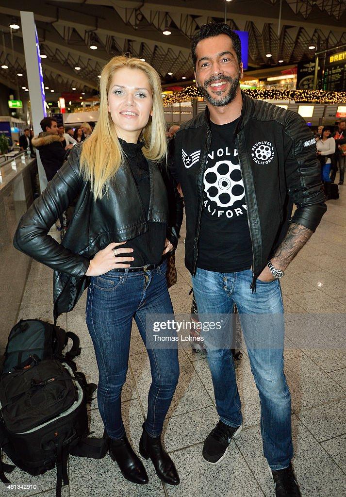 Aurelio Savina and Sarah Kulka pose before the flight to Australia as a participants in the 2015 RTLTVShow 'Dschungelcamp Ich bin ein Star Holt mich...