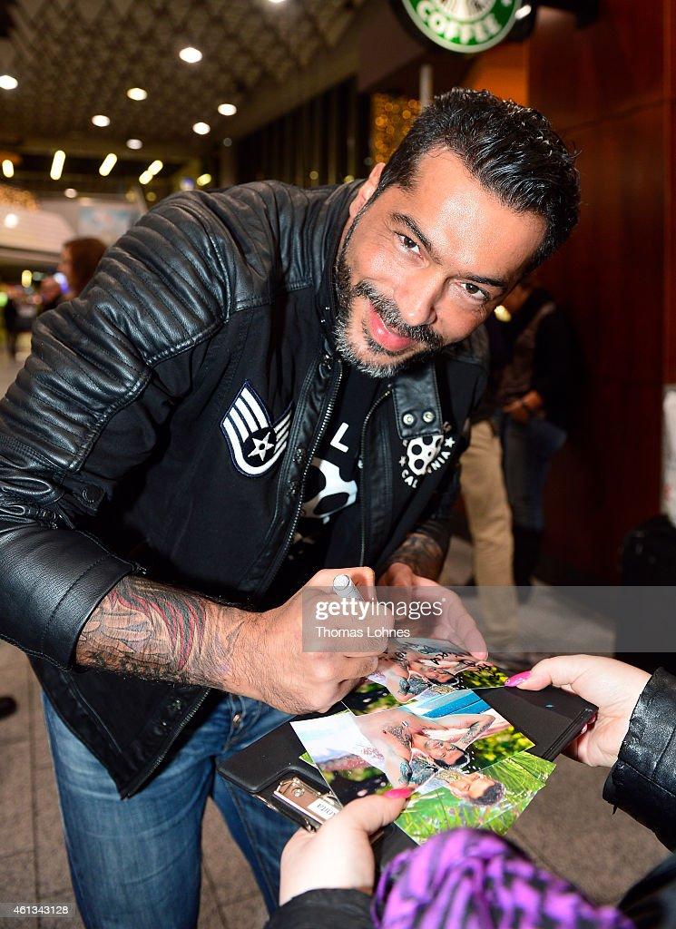 Aurelio Savina signs autographs before the flight to Australia as a participant in the 2015 RTLTVShow 'Dschungelcamp Ich bin ein Star Holt mich hier...